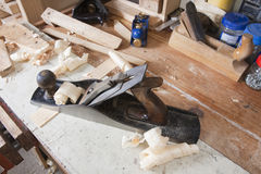 Jointing plane on workbench Royalty Free Stock Images