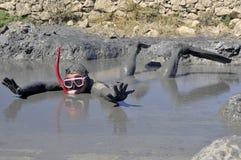 Joke. Man diving in healing mud Royalty Free Stock Images