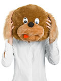 Joke. The girl who keeps toy head of dog in front of his face, simulating that it is his head Royalty Free Stock Images