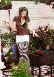 Joke. Eccentric Crazy and Funny Woman Hipster cooks Barbecue on Bbq Grill Stock Photography