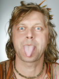 Joke man portrait. Portrait of fun man with one's tongue hanging out Royalty Free Stock Photos