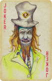 Joker. Mixed media - a hand drawn illustration with scary joker in front of playing card Stock Photo