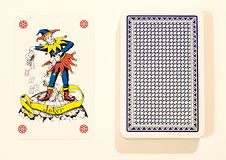 Joker card. Playing card on the table Royalty Free Stock Photos