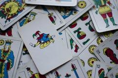 Joker. Card between other cards royalty free stock photos