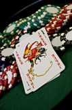 Joker card and poker chips Stock Image