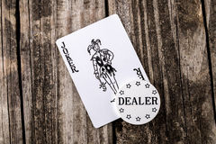 Joker Card on Wood Stock Photography