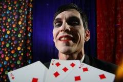 Joker and cards. Smiling Joker face. Dramatic light stock photos