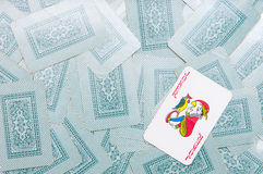 The joker. On the cards background Stock Image