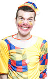 Joker In Clown Costume Laughing At Kids Birthday Royalty Free Stock Images