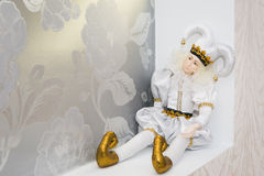 Joker doll,  on white background. Doll harlequin, decoration of the hall, Stock Images