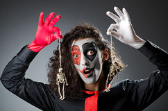 Joker with face mask Royalty Free Stock Image