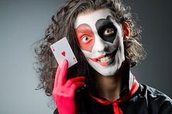 Joker with face mask Stock Images
