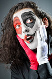 Joker with face mask Stock Image