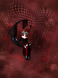 Joker. A gothic harlequin sitting on a moon in dark red clouds Stock Image