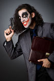 Joker with gun Royalty Free Stock Photography