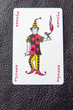 Joker. Playing cards on a black surface Royalty Free Stock Photo