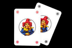 Joker playing cards. Isolated on black background Royalty Free Stock Photos