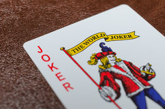 Joker sur le divan Photo stock
