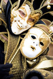 A joker at the Venice Carnival. Holding a mask Stock Images