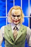 The joker (the wax version). The joker behind bar, batmans arch nemesis Stock Photography