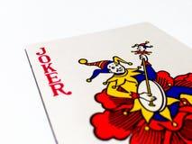 Jokerkort med vit bakgrund royaltyfri bild