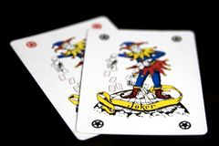 Jokers. Two joker playing cards on black background. The word Joker is in focus Stock Photography
