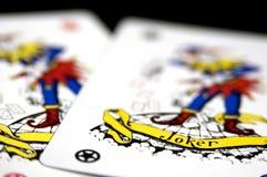 Jokers. Two joker playing cards on black Stock Photos