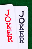 Jokers on green, closeup Royalty Free Stock Image