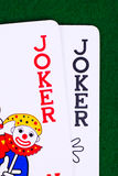 Jokers on green, closeup Royalty Free Stock Photography