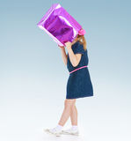 Jokes girl wearing on his head a paper bag. Stock Photography