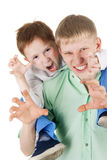 Joking. Two adult and kid brothers frighten joking Royalty Free Stock Image