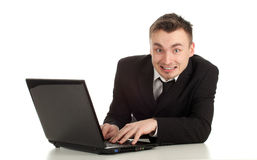 Joking businessman working on laptop Royalty Free Stock Image
