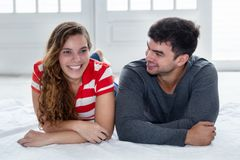 Joking caucasian love couple looking at camera in new apartment Royalty Free Stock Photo