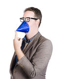 Joking man wearing party hat on face. Party animal Royalty Free Stock Image