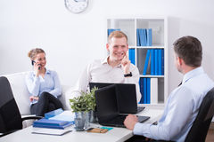 Joking in the office Stock Image