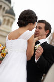 Joking time. Young woman asking a kiss to her groom stock photo