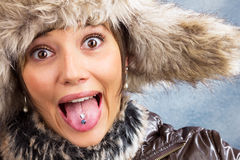 Joking woman with fur hat, close up portrait Royalty Free Stock Images
