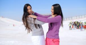 Joking women strangling each other Stock Photos