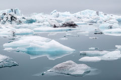 Jokulsarlon glacial Lagoon. In iceland stunning landscape where icebergs float around and form large chunks of ice which deposit on diamond beach Stock Photography