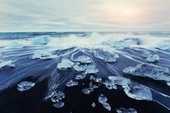 Jokulsarlon glacier lagoon, fantastic sunset on the black beach, Stock Photo
