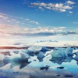 Jokulsarlon glacier lagoon, fantastic sunset on the black beach, Stock Photography