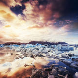 Jokulsarlon glacier lagoon, fantastic sunset on the black beach, Royalty Free Stock Photos