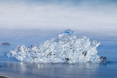 Jokulsarlon Ice in morning sun lights on sea beach Royalty Free Stock Photos