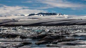 Jokulsarlon. Mountain and melting icebergs in Jokulsarlon, Iceland Stock Photos