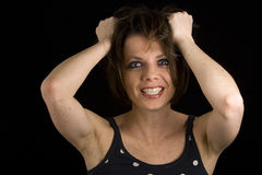 Joli Brunette - tirant le cheveu Images stock