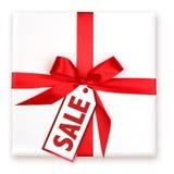 Joli cadeau de vacances enveloppé avec la VENTE décorée Ta Photo libre de droits