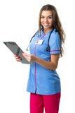 Joli docteur de sourire de femme avec le dossier Photo stock