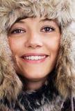 Joli femme avec le chapeau de fourrure Photos stock