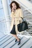 Joli femme d'affaires au téléphone Photographie stock