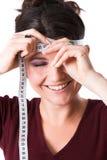 Joli femme mesurant son front Photographie stock libre de droits